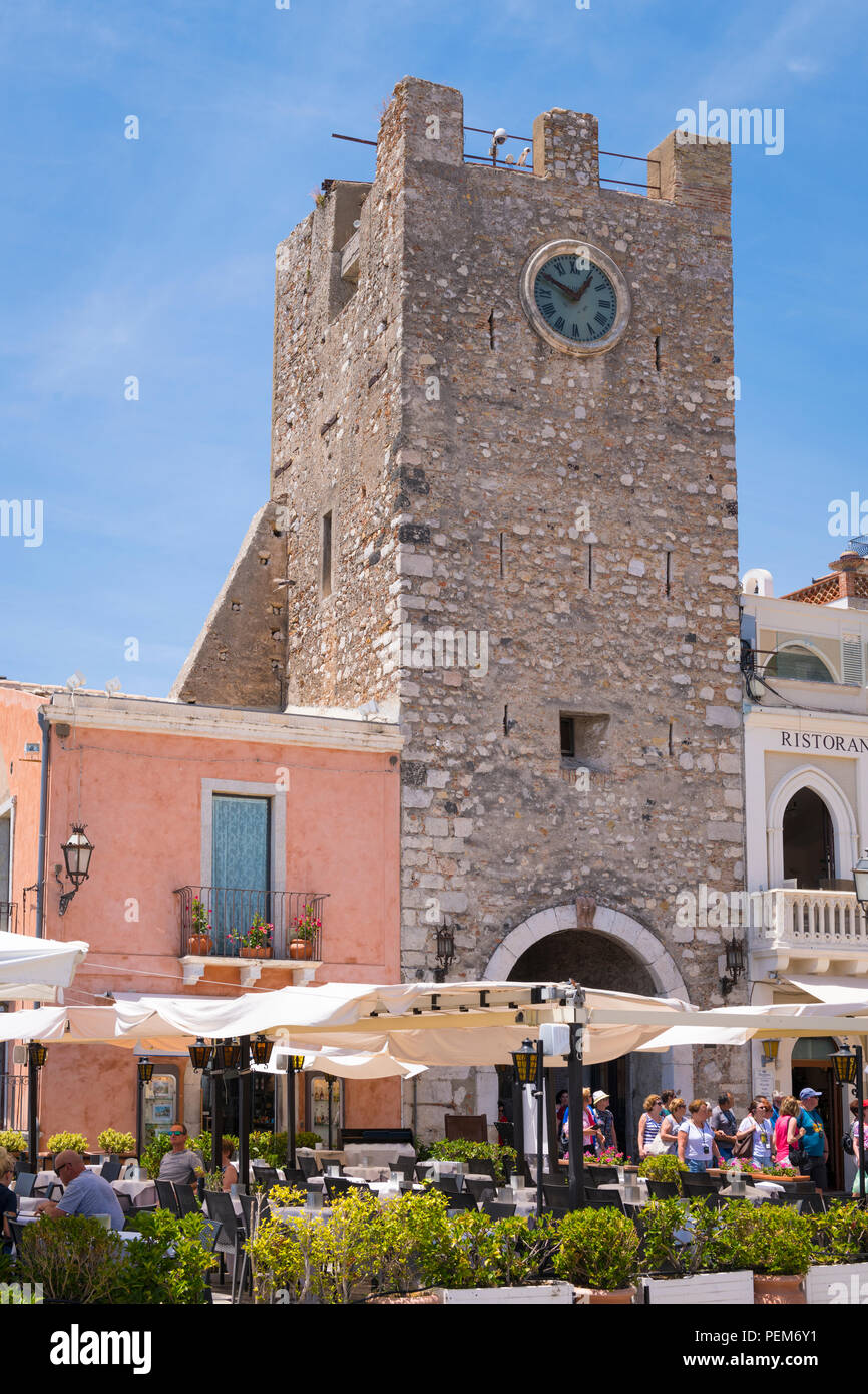 Italy Sicily Monte Tauro most famous luxury tourist resort Taormina typical pedestrian street scene Torre dell Orlogio watch tower restaurant - Stock Image