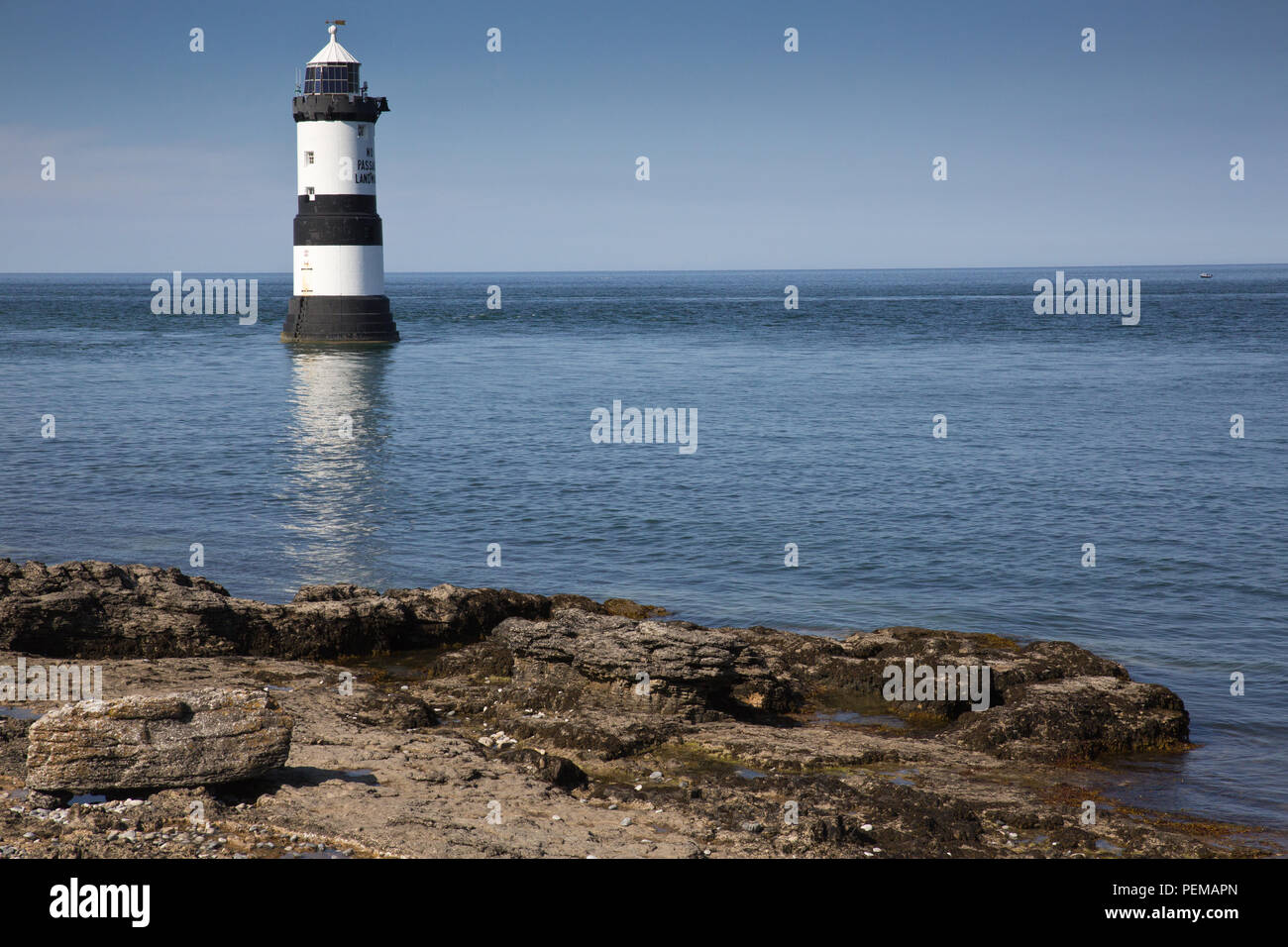 Penmon Lighthouse and Puffin Island, Anglesey Stock Photo