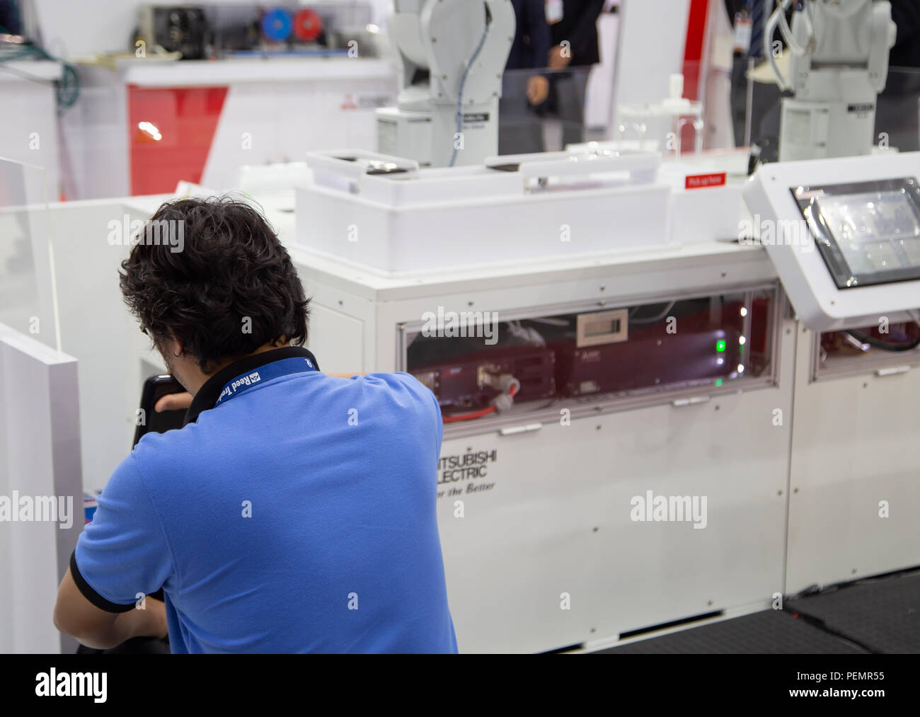 Bangkok, Thailand - June 20, 2018: Technician repair automation robot machine in Manufacturing Expo 2018 - Stock Image