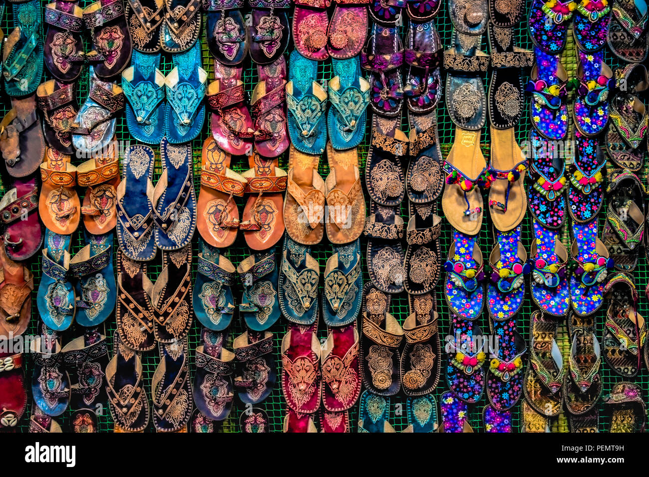 928ab8deb91e Kolhapuri Chappal- Colorful and variety of Ladies Ethnic Footwear displayed  on sale at the street