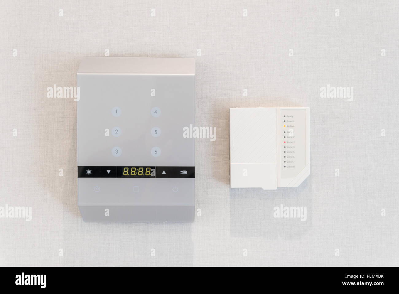 Dial of a domestic property alarm with function buttons Stock Photo
