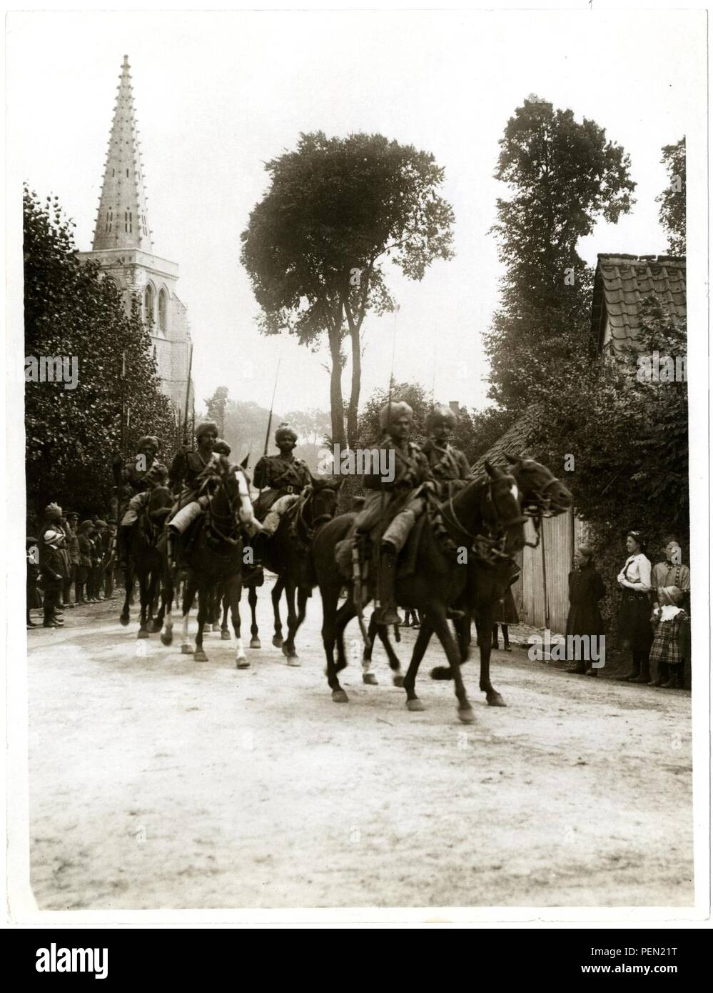 Indian cavalry marching through a French village [Estr u00e9e Blanche]. Photographer  H. D. Girdwood. - Stock Image