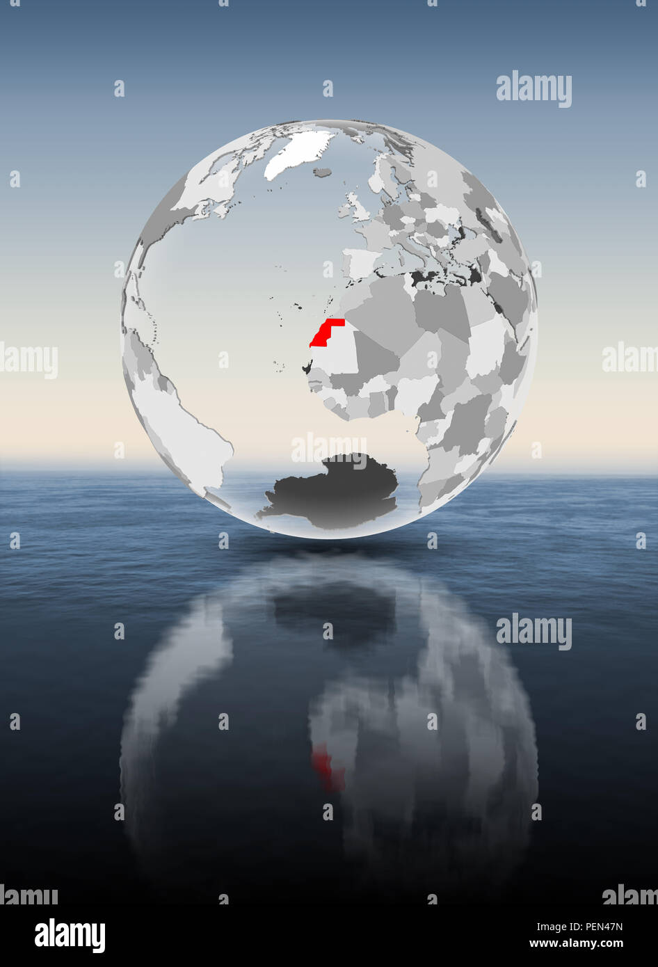 Western Sahara in red on translucent globe floating above water. 3D illustration. - Stock Image