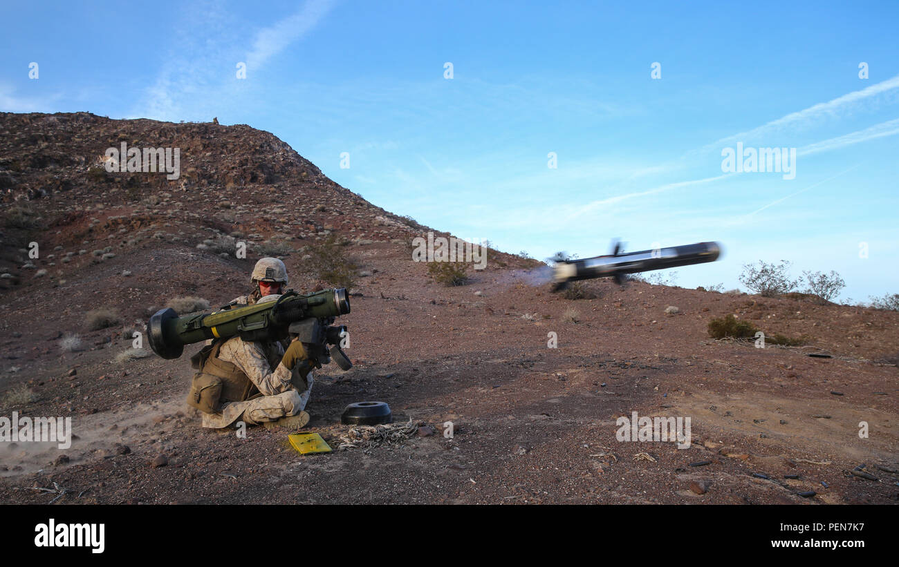 Marines fire an FGM-148 Javelin anti-tank missile during the company supported, live-fire assault portion of a Marine Corps Combat Readiness Exercise at Marine Corps Air Ground Combat Center Twentynine Palms, Calif., Dec. 7, 2015. The purpose of a MCCRE is to evaluate Marines' collective performance in specific mission requirements that will prepare them for their upcoming deployment rotation. The Marines are with 2nd Battalion, 7th Marine Regiment, 1st Marine Division. (U.S. Marine Corps photo by Lance Cpl. Devan K. Gowans) - Stock Image