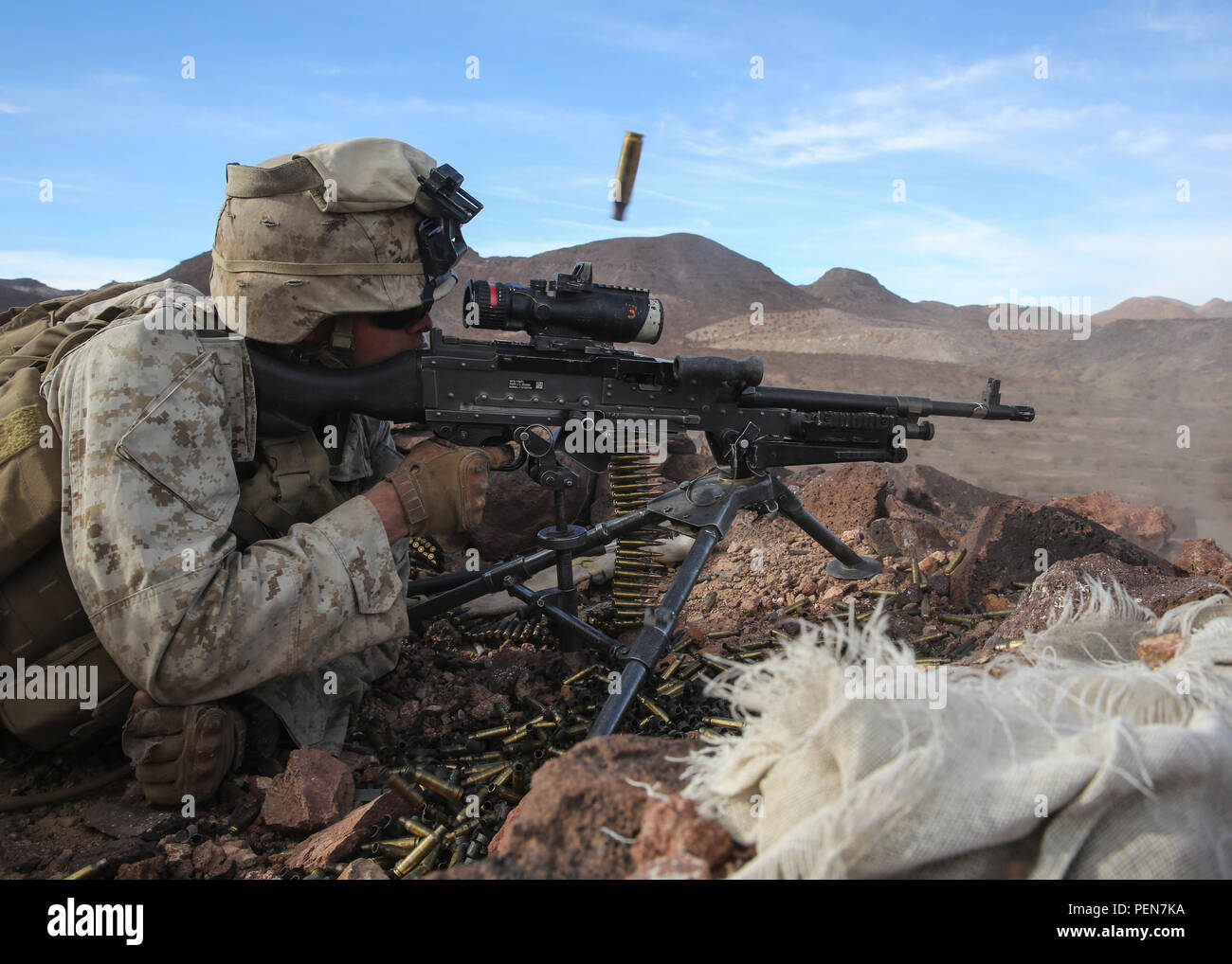 Pfc. Garrett Beck fires an M240B medium machine gun at distant targets during the company supported, live-fire assault portion of a Marine Corps Combat Readiness Evaluation at Marine Corps Air Ground Combat Center Twentynine Palms, Calif., Dec. 7, 2015 The purpose of a MCCRE is to evaluate Marines' collective performance in specific mission requirements that will prepare them for their upcoming deployment rotation. Beck is a machine gunner with Company F, 2nd Battalion, 7th Marine Regiment, 1st Marine Division. (U.S. Marine Corps photo by Lance Cpl. Devan K. Gowans) - Stock Image