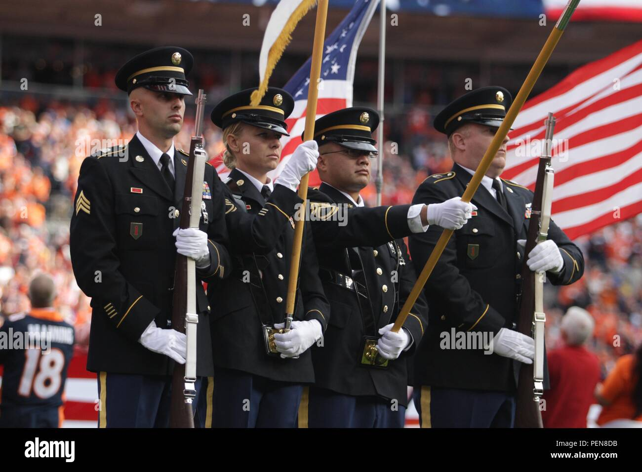 2d40ef6a9 Members of the Colorado National Guard Honor Guard present the colors  during the opening ceremonies for the Salute to Service game between the  Denver ...