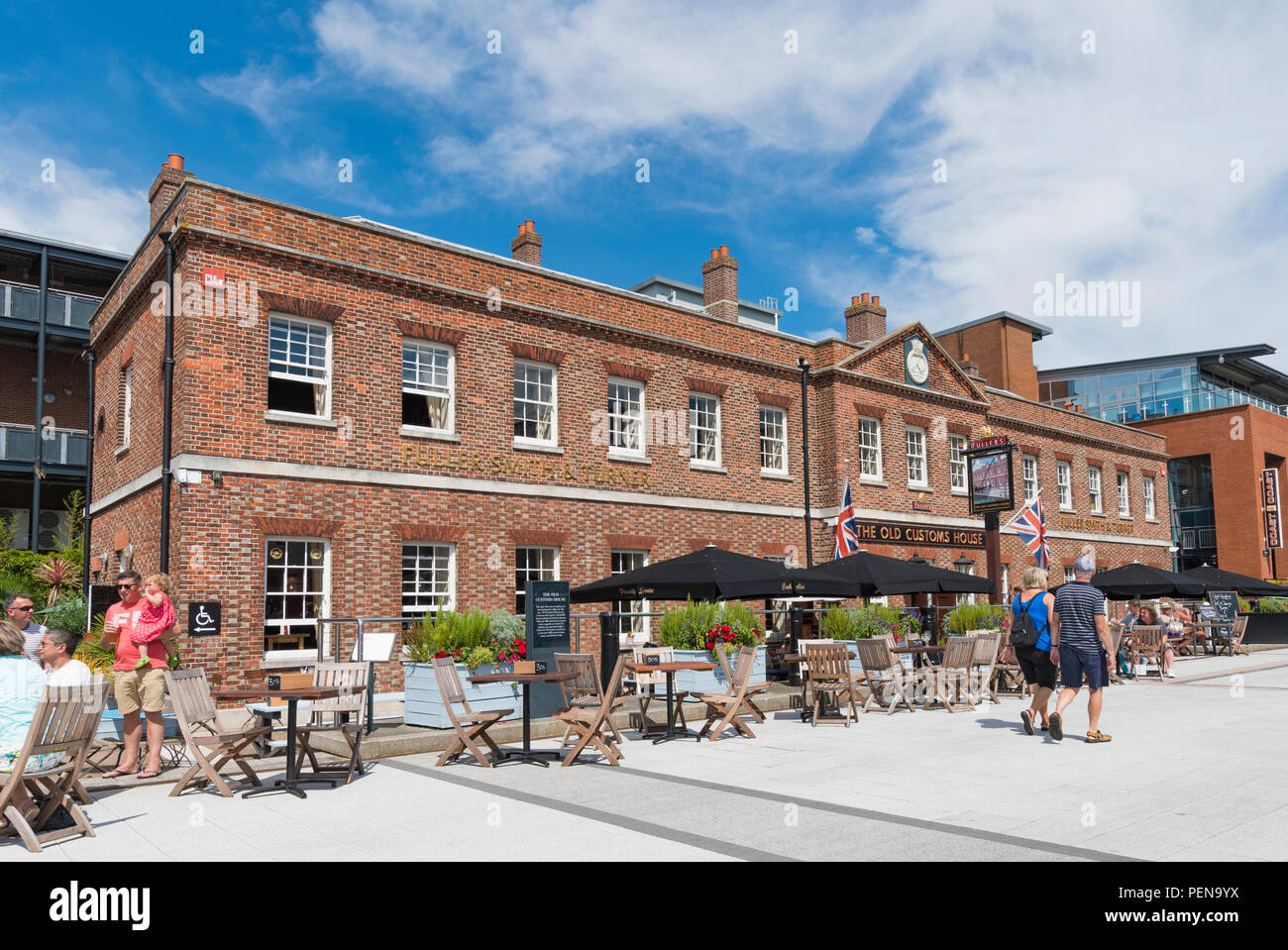 The Old Customs House pub in Gunwharf Guays, Portsmouth, Hampshire, England, UK. Fullers Smith and Turner public house. - Stock Image