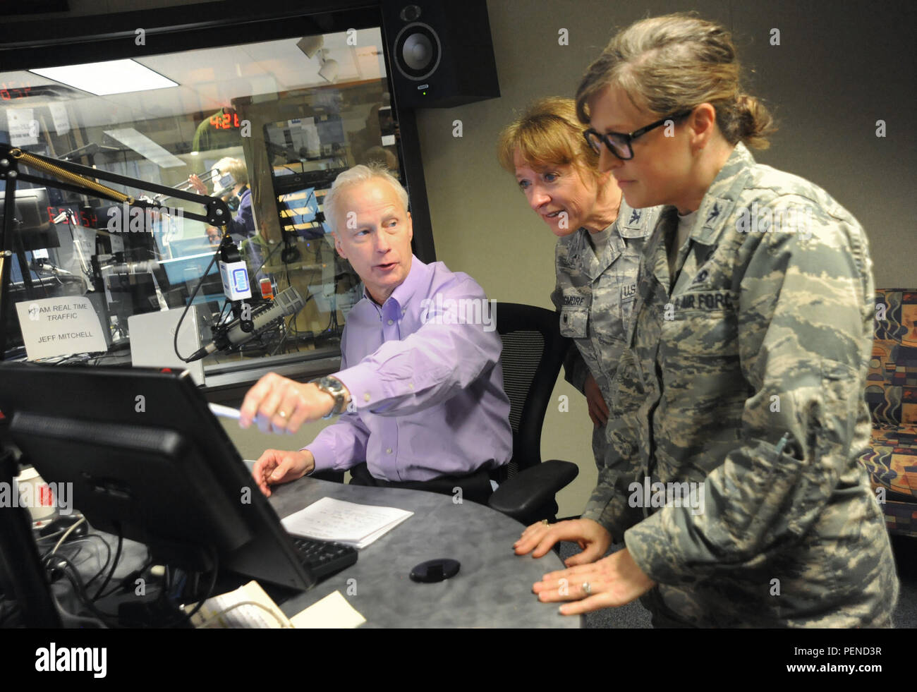 Oregon Air National Guard Cols. Donna Prigmore, left, and Jenifer Pardy, right, participate in an on-air discussion during the Mark and Dave Radio Program, KPAM 860 radio, as part of Operation Santa Claus, an annual fundraiser, which assists local families coping with income loss due to military deployment, Dec. 4, 2015, in Clackamas, Ore. (U.S. Air Force photo by Tech. Sgt. John Hughel, 142nd Fighter Wing Public Affairs) - Stock Image