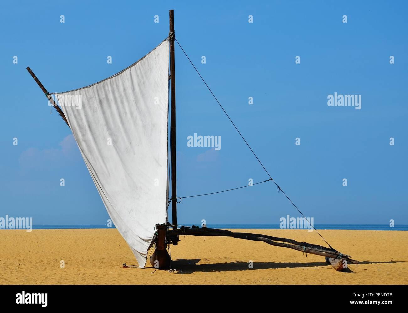 Oruwa fishing boats on Negombo Beach, Sri Lanka - Stock Image