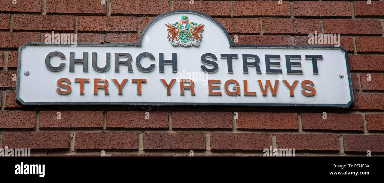 Bilingual street name in English and Welsh for Church Street Stryt yr Eglwys in Wrexham Wales June 2018 - Stock Image