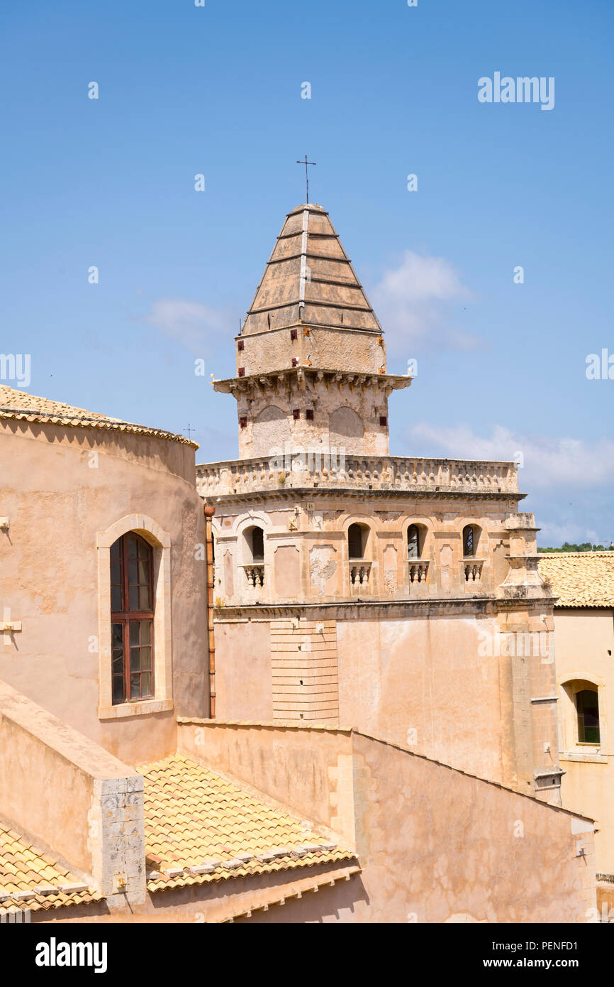 Italy Sicily ancient Netum Noto Antica Mount Alveria rebuilt after 1693 earthquake roof scene Church tower balconies spire cross clouds roof tiles - Stock Image