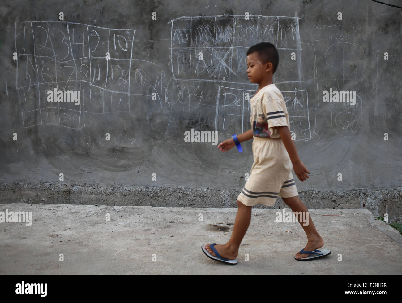 Kid passing through an alley - Stock Image