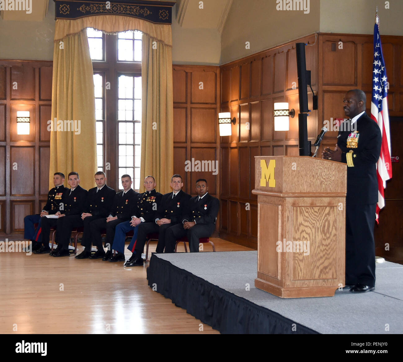 ANN ARBOR, Mich., (December 18, 2015) – Rear Adm. Stephen C. Evans, commander, Naval Service Training Command (NSTC), gives the keynote speech to University of Michigan Naval Reserve Officer Training Corps (NROTC) midshipmen and their family members and friends during a commissioning ceremony in The Michigan League building on campus here, Dec. 18. (Official U.S. Navy photo Scott A. Thornbloom) - Stock Image