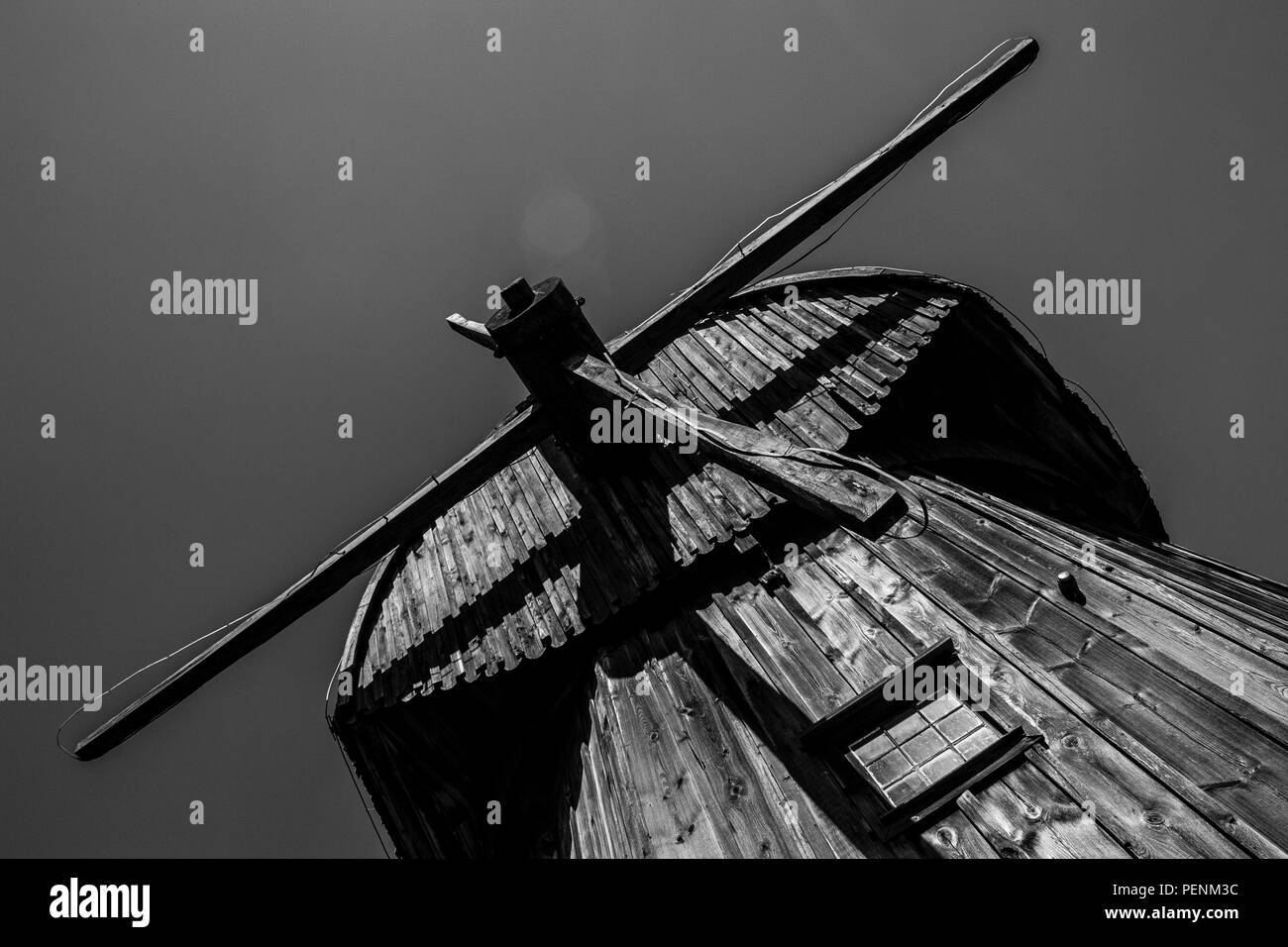 Old wooden windmill in Open Air Village Museum in Lublin, Poland, Monochrome - Stock Image
