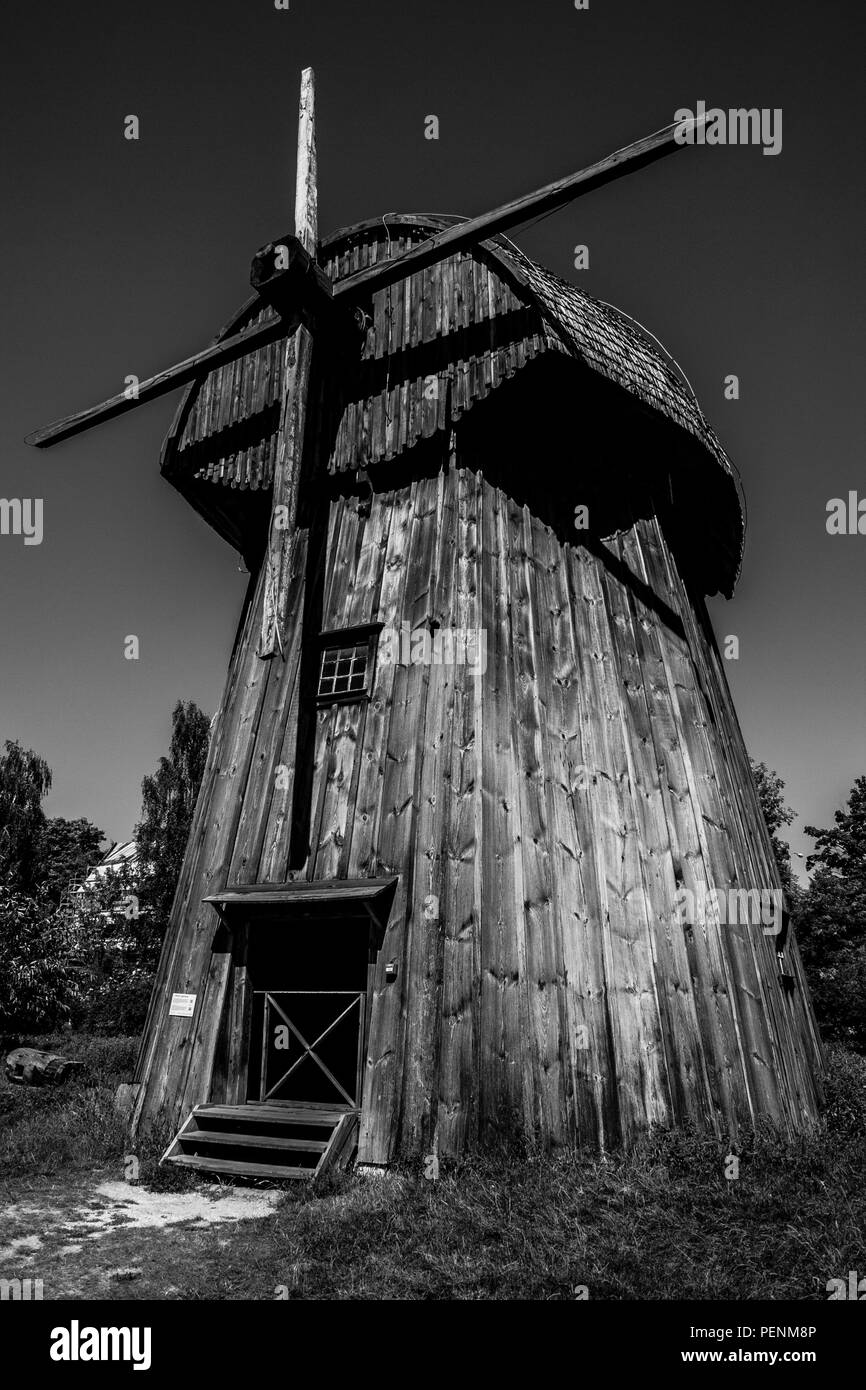 Monochrome old wooden windmill in Open Air Village Museum in Lublin - Stock Image