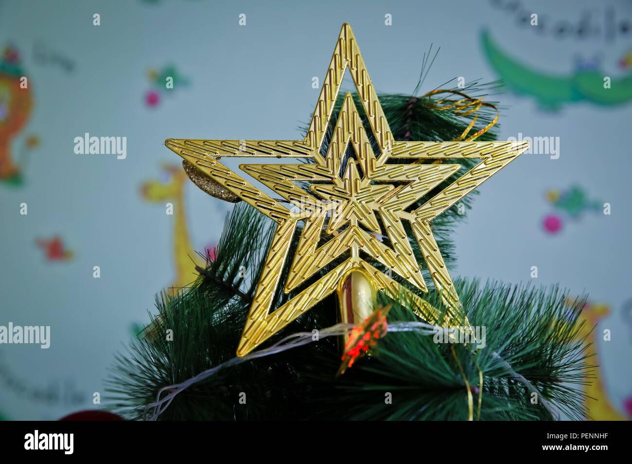 photo of yellow christmas star for christmas tree five star stock image