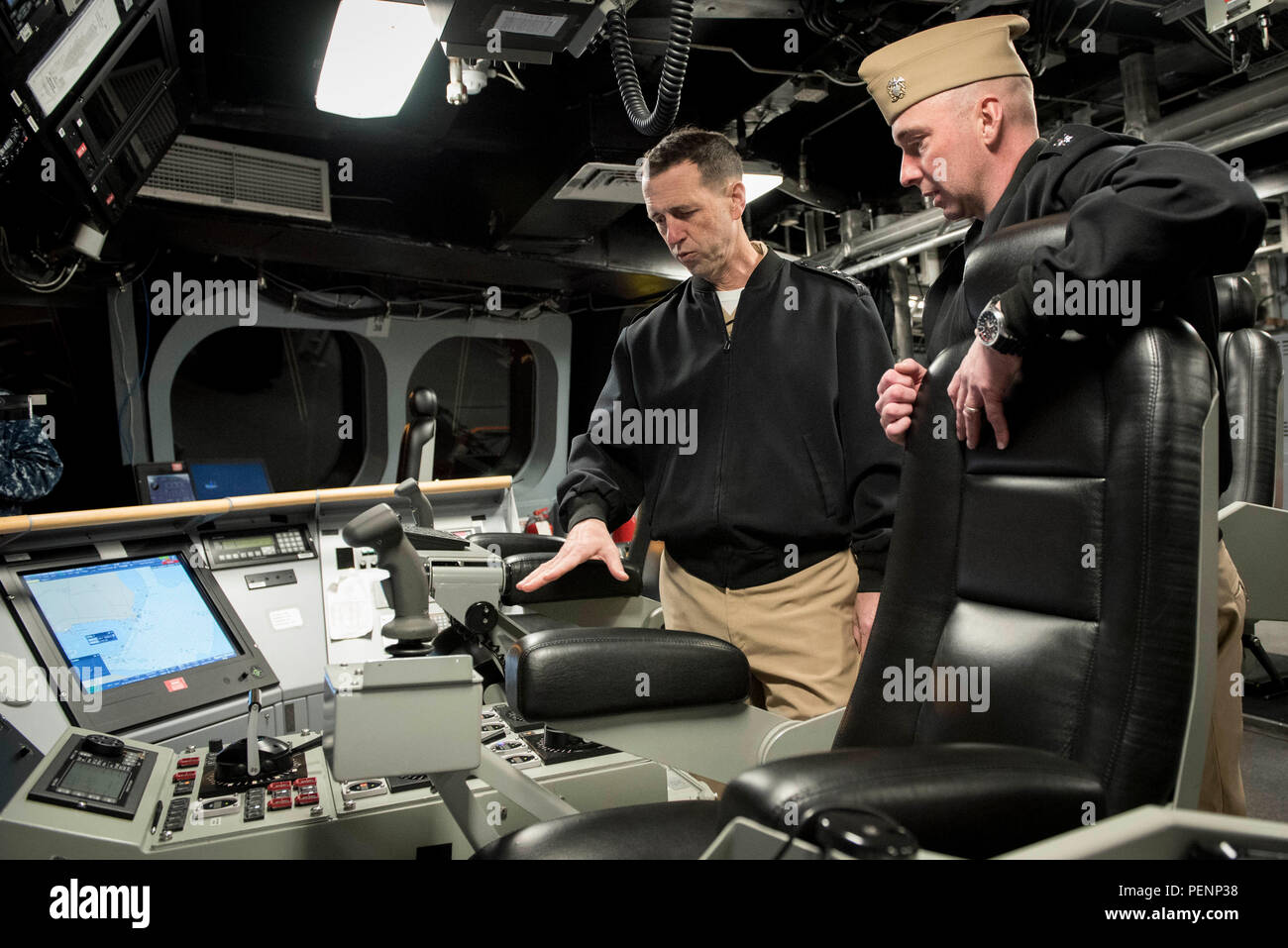 160106-N-AT895-341 PENSACOLA, Fla. (Jan. 6, 2016) Chief of Naval Operations (CNO) Adm. John Richardson tours the littoral combat ship USS Independence (LCS 2). LCS 2 is conducting operational evaluation and testing of the mine countermeasures mission package while berthed at Naval Air Station (NAS) Pensacola. Richardson and Master Chief Petty Officer of the Navy (MCPON) Mike Stevens received an overview of NAS Pensacola's aviation training centers and toured LCS 2. (U.S. Navy photo by Mass Communication Specialist 1st Class Nathan Laird/Released) Stock Photo