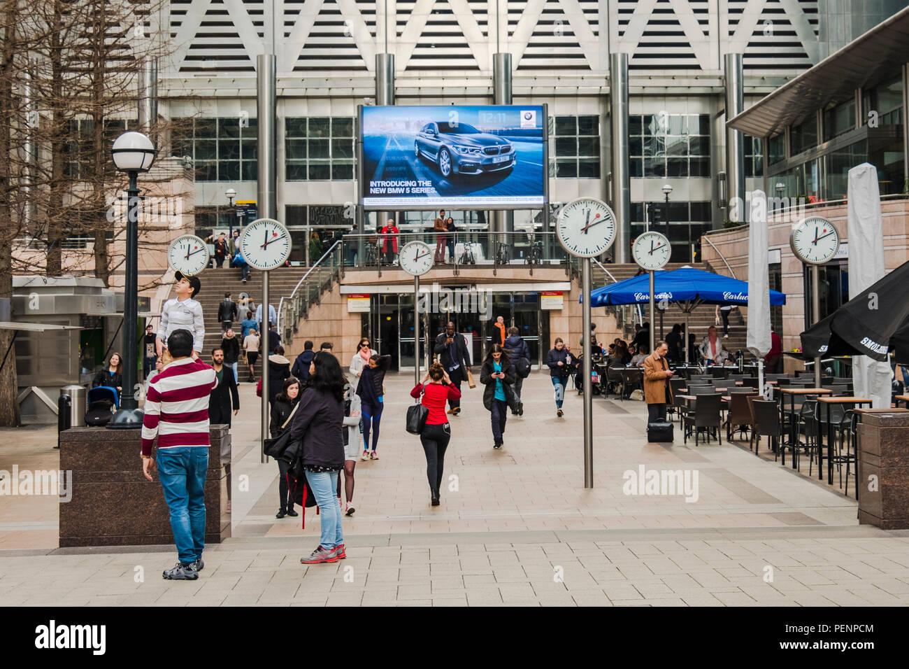Clocks in London Docklands - Stock Image