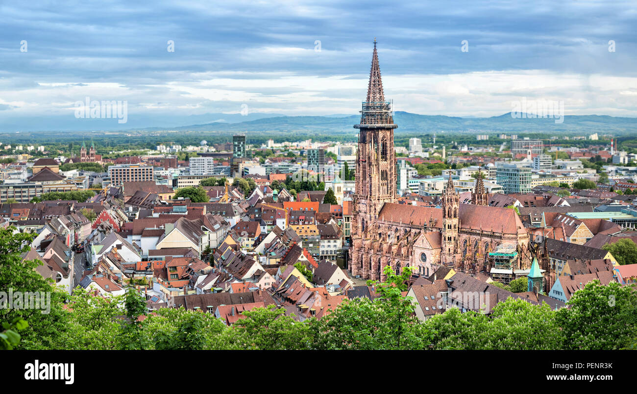 Aerial panorama of Freiburg im Breisgau with Cathedral on foreground, Germany - Stock Image
