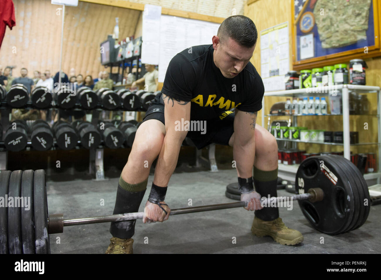 A Service Member Competes In The 400 1 000 Pound Powerlifting Competition At The Rock Fitness Center