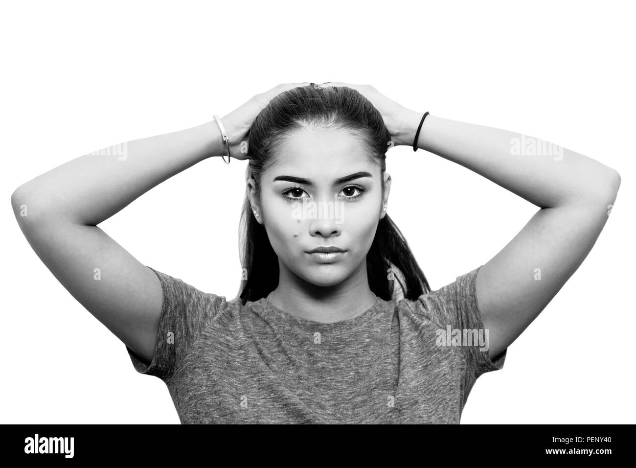 Portrait of beautiful girl half english half thai in sport look isolated in black and white