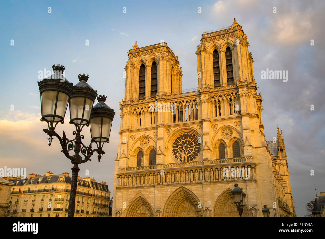 Setting sunlight on the front facade of Cathedral Notre Dame, Paris, France - Stock Image