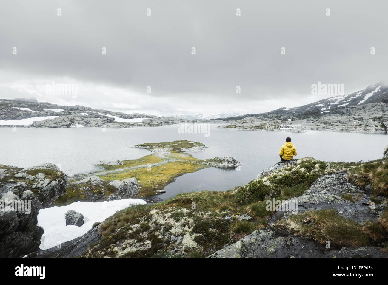 Typical norwegian landscape with snowy mountains - Stock Image