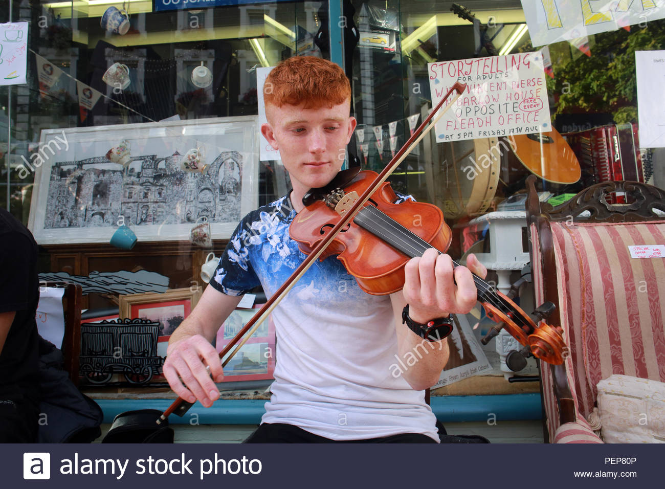 Drogheda, Ireland. 16th Aug 2018. A local young musician plays a tune as the Fleadh Cheoil continues in Drogheda Ireland. Huge crowds of . visitors are expected to attend the event over the coming weekend Credit: Clearpix/Alamy Live News - Stock Image