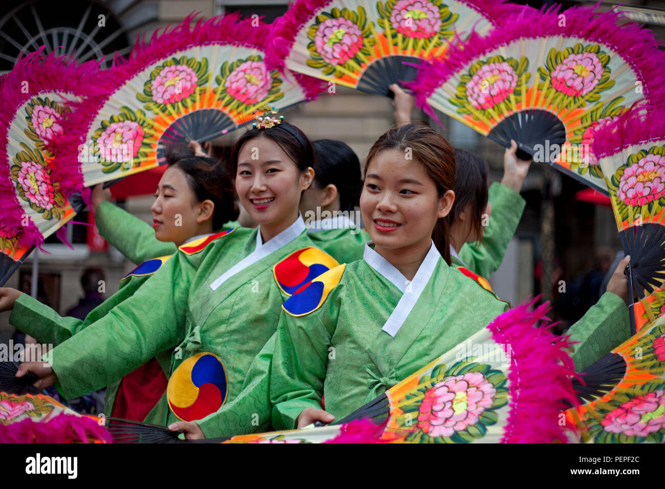 Edinburgh, Scotland, UK 17 August 2018. Edinburgh Fringe Royal Mile adding colour to the High Street Members of Soon Chun Hyang Uni English Drama Club promote their joyful and never too serious The Merry Wives of Seoul as a new adaptation of The Merry Wives of Windsor, Shakespeare's comedy of love and marriage. - Stock Image