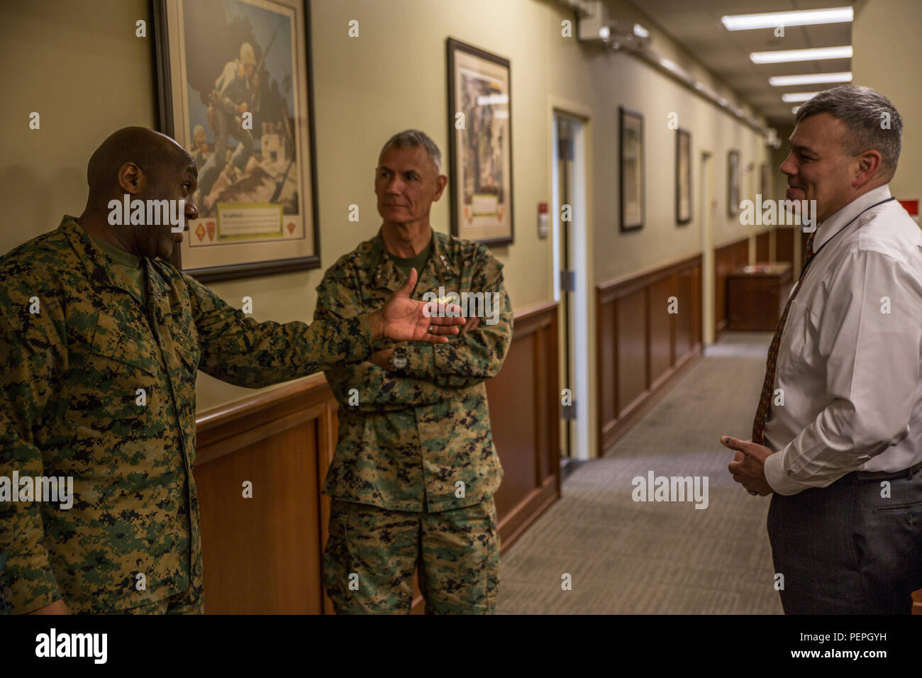Sergeant Major of the Marine Corps, Sgt. Maj. Ronald L. Green (left), greets Lt. Gen. Rex C. McMillian (center), Commander of Marine Forces Reserve and Marine Forces North and Mr. Gregg T. Habel (right), Executive Director of MARFORRES and Marine Forces North, upon arrival at Marine Corps Support Facility New Orleans, Jan. 20, 2016. Green's visit entails getting to know his Marines better as well as discussing the 'Protect What You've Earned' campaign by urging Marines to protect what they've earned as a Marine and continue to uphold the standards of the Corps on and off duty. - Stock Image