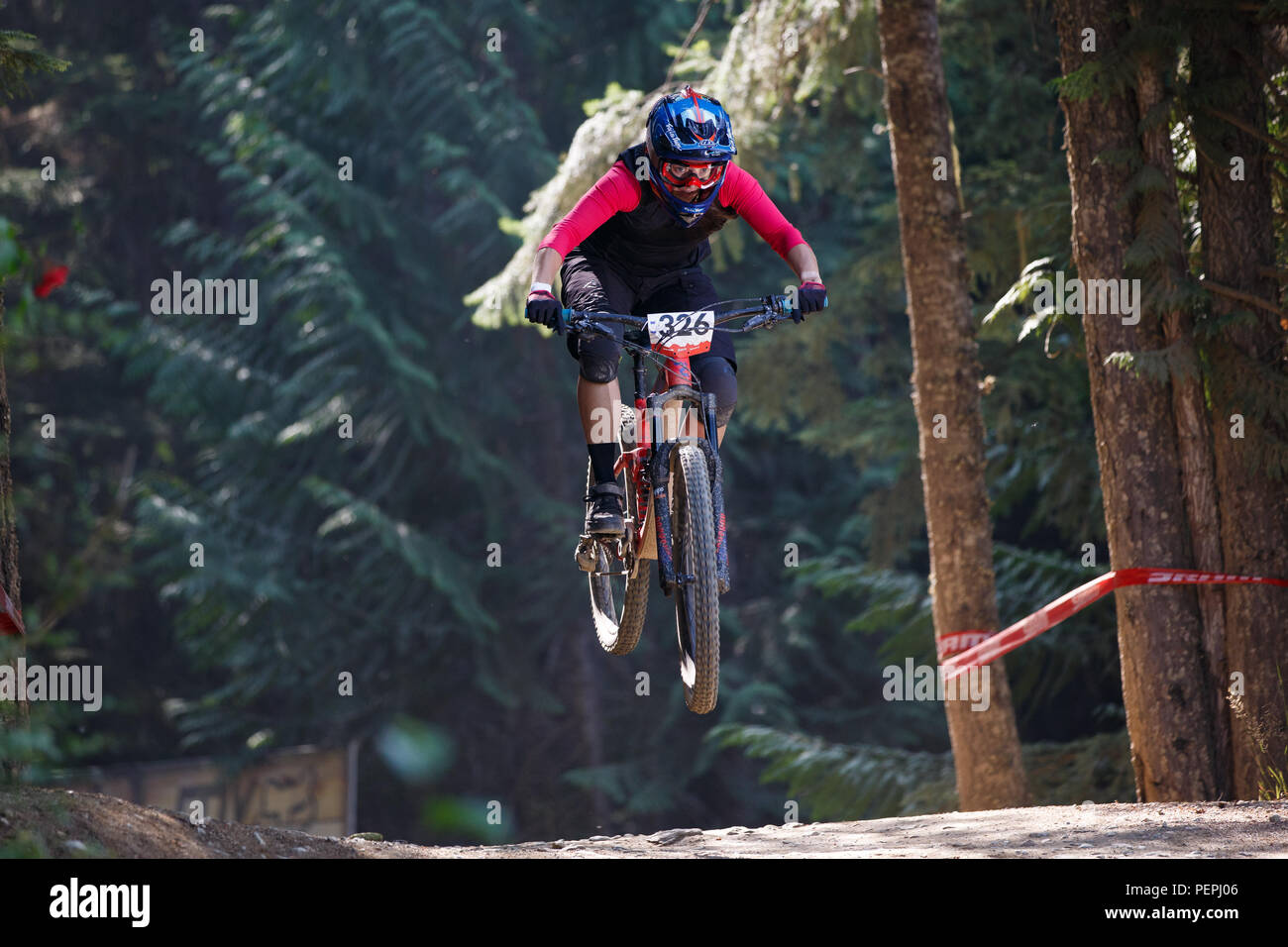 Leonie Picton (AUS) riding to fifth place pro women in the 2018 Crankworx Fox Air DH competition in Whistler, BC, Canada. August 15, 2018. - Stock Image