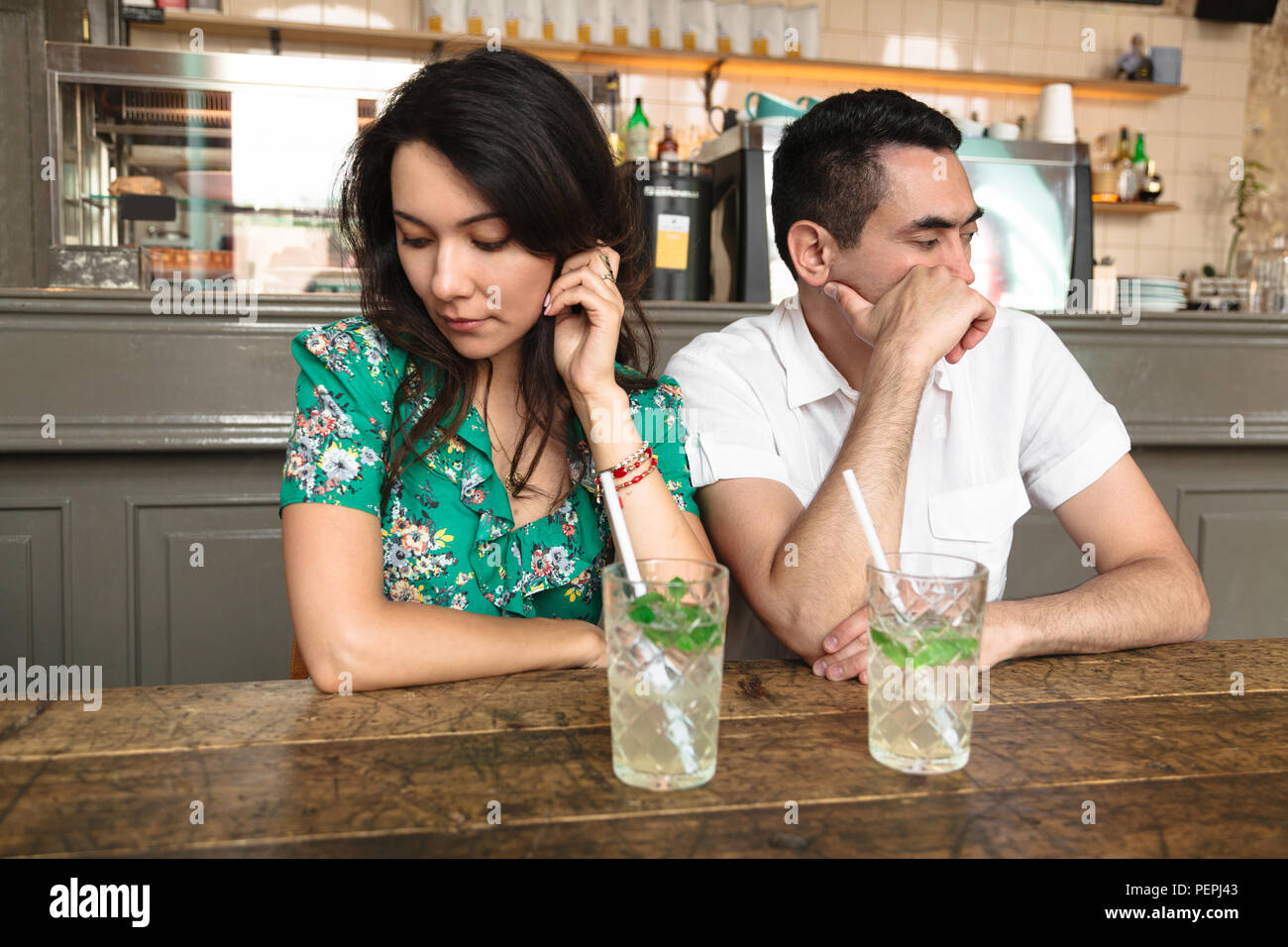Young couple turned away from each other Stock Photo