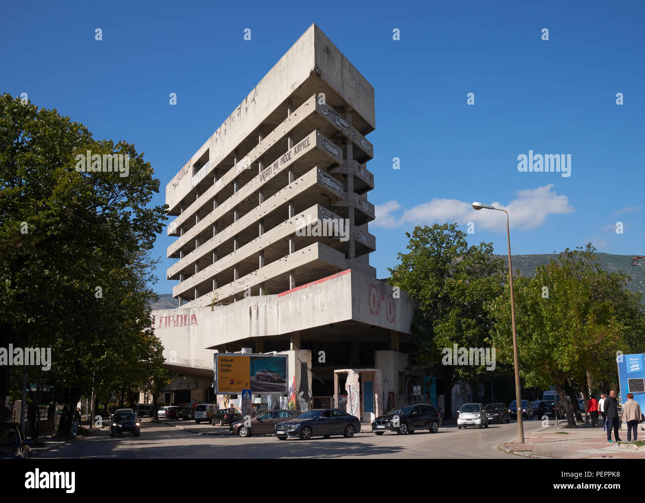 The derelict former Ljubljanska Bank in Mostar, Bosnia and Herzegovina, has been called the 'Sniper Tower' since the Balkans War in the 1990s. - Stock Image