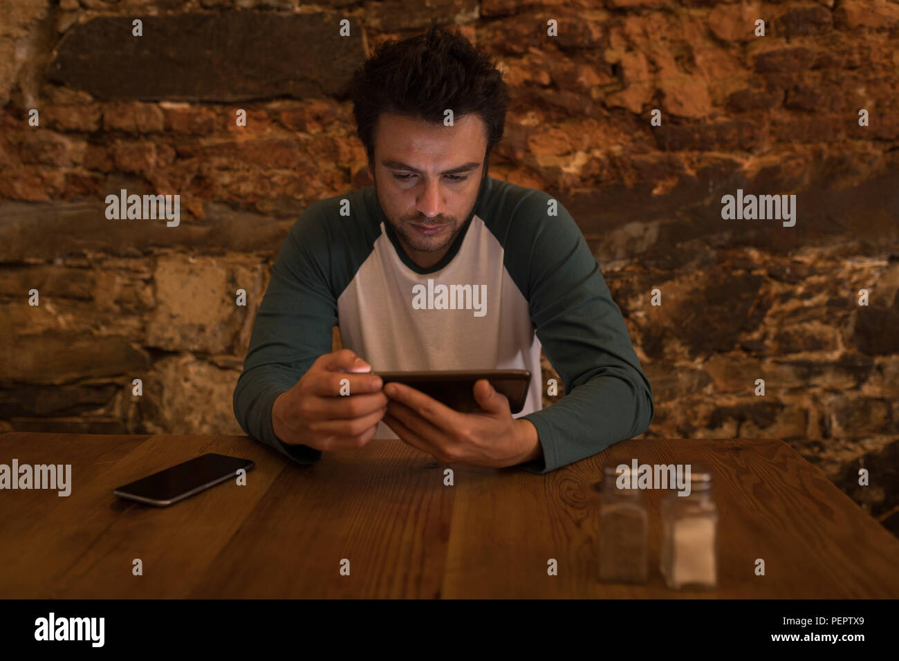 Businessperson using a digital tab - Stock Image
