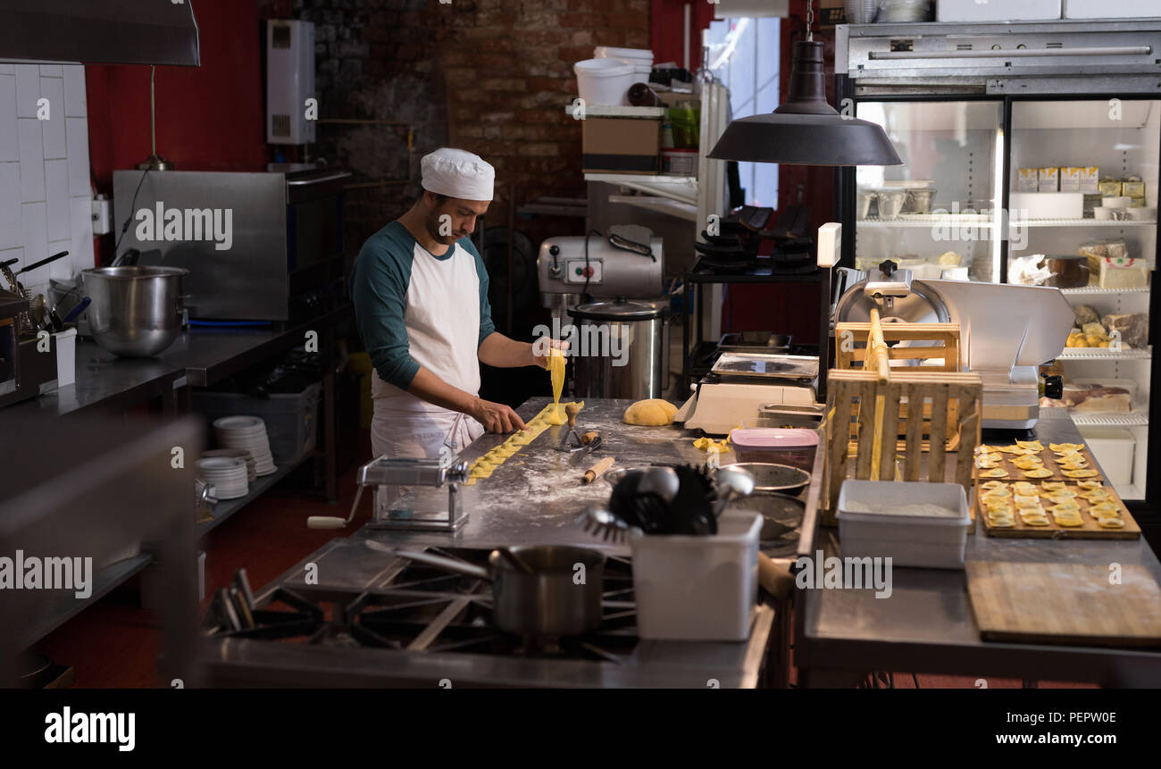 Male baker preparing for making pasta - Stock Image