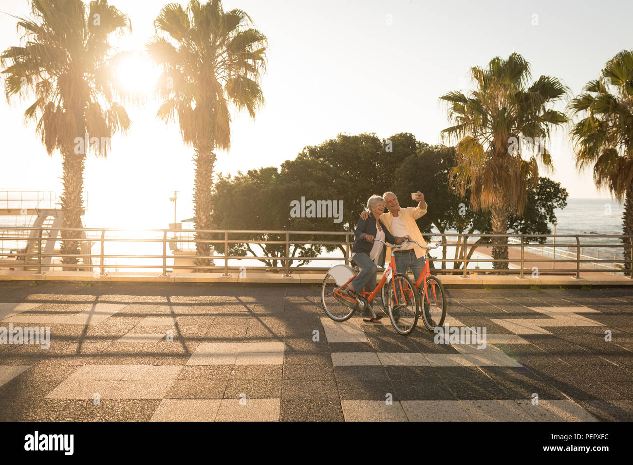 Senior couple taking selfie at promenade - Stock Image