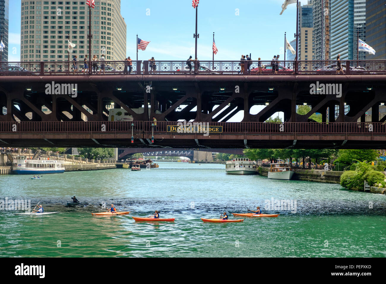 Kayaks on The Chicago River with DuSable Bridge (Michigan Ave) and surrounding downtown architecture in summer, Chicago, Illinois, USA - Stock Image