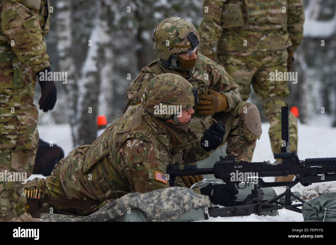 Soldiers of 3rd Squadron, 2nd Cavalry Regiment, stationed at Vilseck, Germany, identify their target before firing during a training exercise at Adazi Training Area in Latvia, Jan. 25, 2016. (U.S. Army photo by Staff Sgt. Steven Colvin/Released) - Stock Image