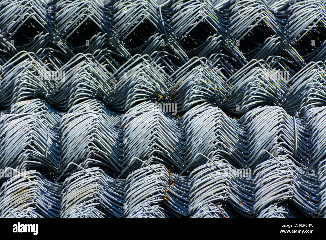 Rolls of galvanized steel wire mesh with a large cell and twisted ...