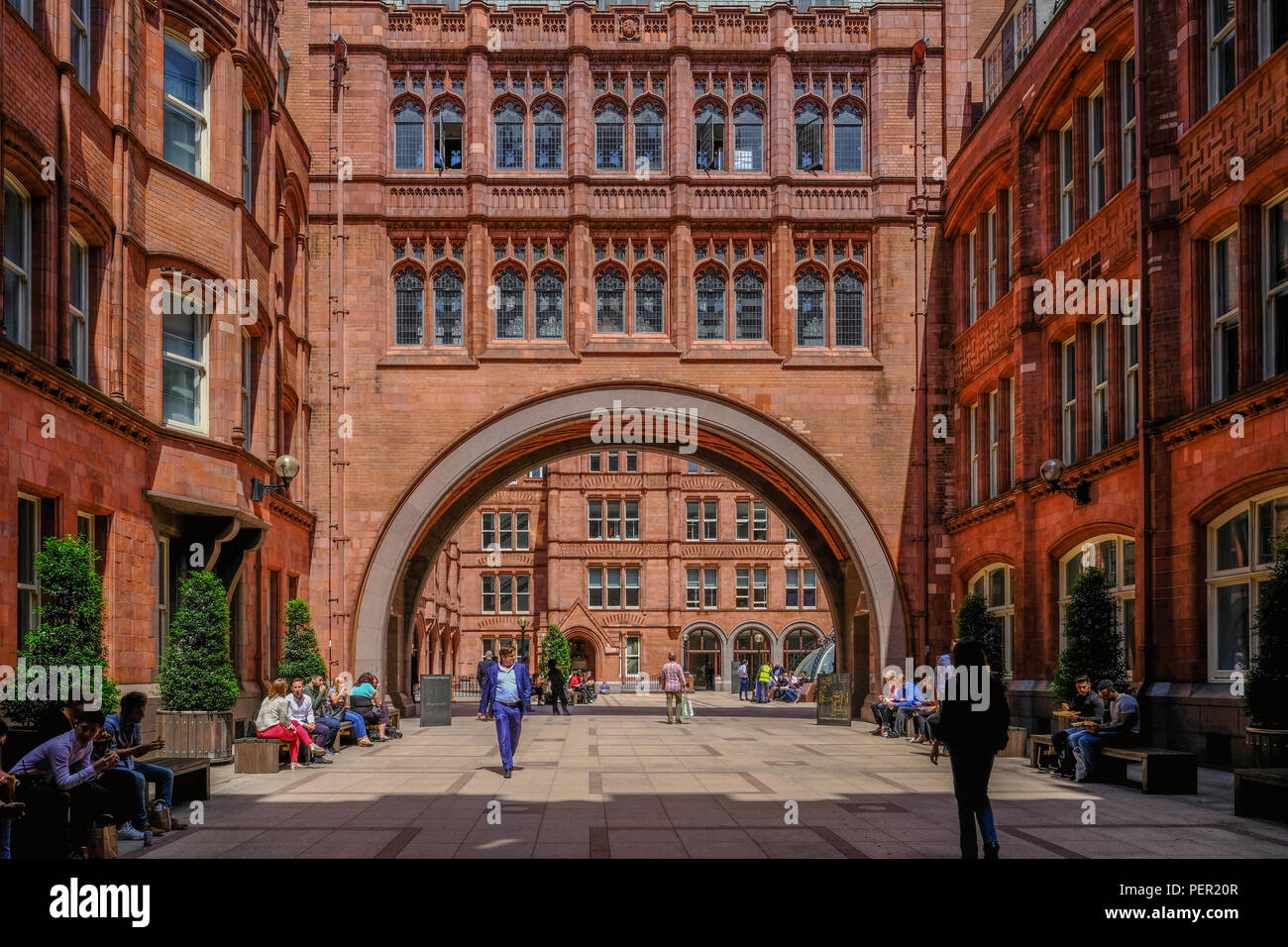 Holborn, London, UK - June 8, 2018: View of the inner courtyard of the Prudential Building in Holborn and shows people enjoying their break time on a  Stock Photo