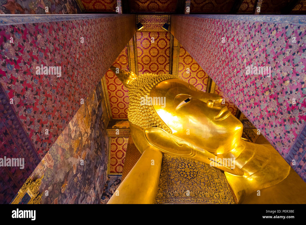 big golden buddha head in Wat Pho buddhist temple in Bangkok , Thailand - Stock Image
