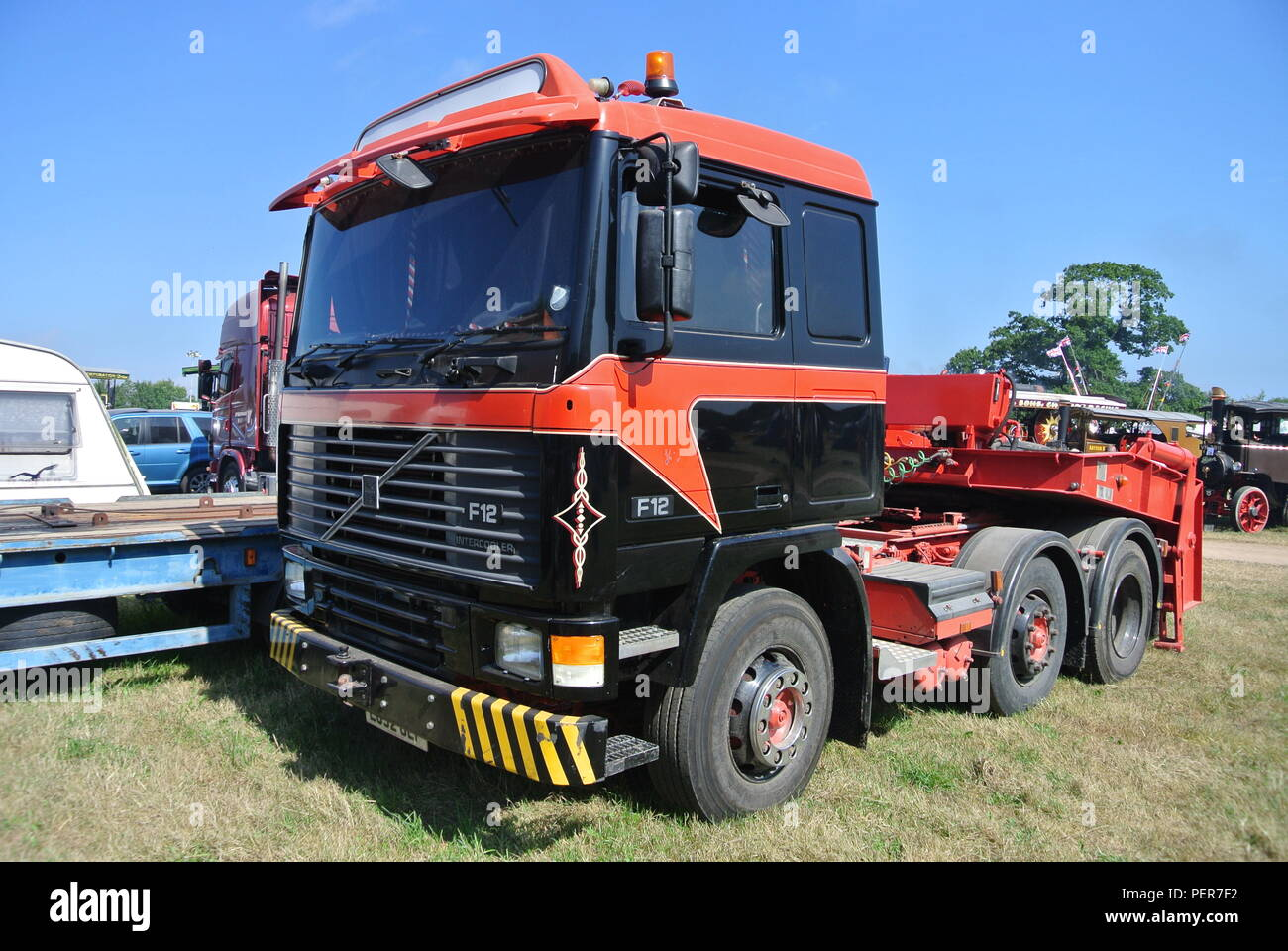 a Volvo F12 lorry with low loader attachment at Torbay Steam Fair, Churston, Devon, England. - Stock Image