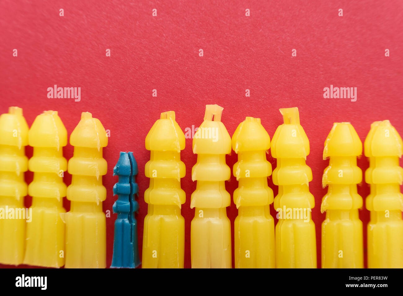 Plastic screw plugs, showing a difference - Stock Image