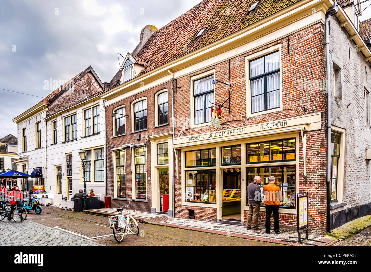 Historic Brick Houses in 14th century old Dutch fishing village of Elburg in the Netherlands - Stock Image