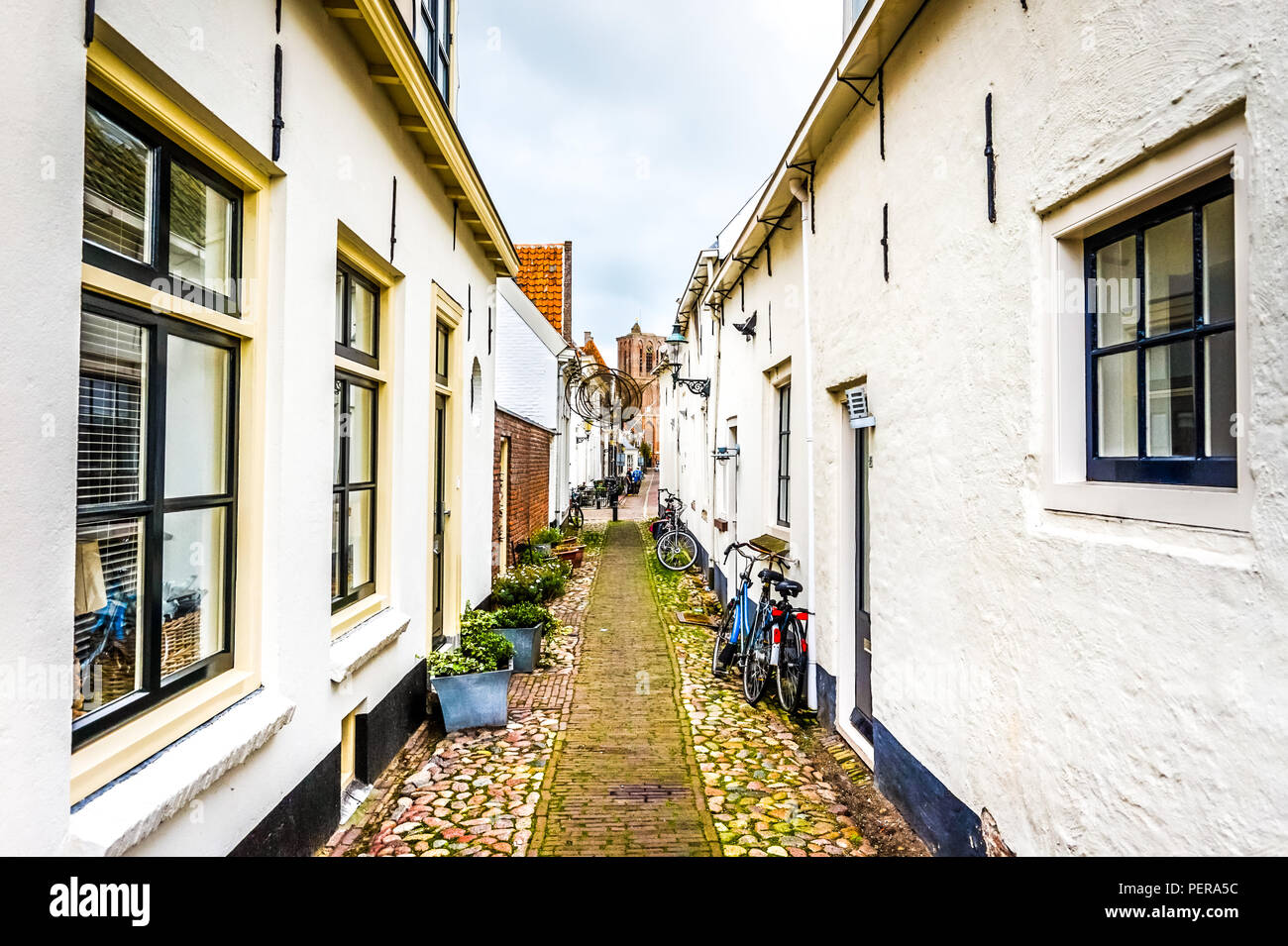 Narrow cobblestone streets in the centuries old Dutch fishing village of Elburg in the heart of Holland - Stock Image