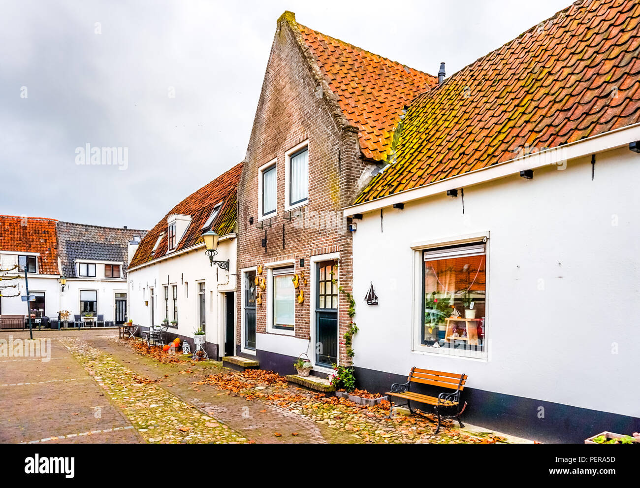 Historic Brick Houses in 14th century old Dutch fishing village of Elburg - Stock Image