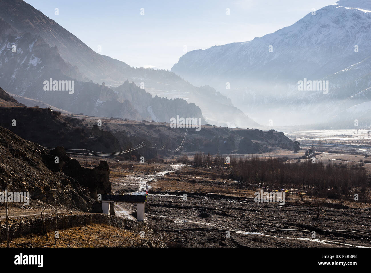 Morning dream like atmosphere along the Annapurna circuit hiking trail just out of Manang in the Himalayas in Nepal - Stock Image