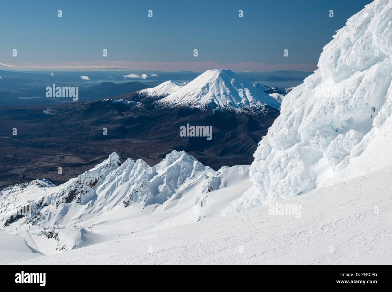 View of Mount Ngauruhoe and Tongariro from the top of Mount Rupaehu in winter. New Zealand, National Park, Tongariro Stock Photo