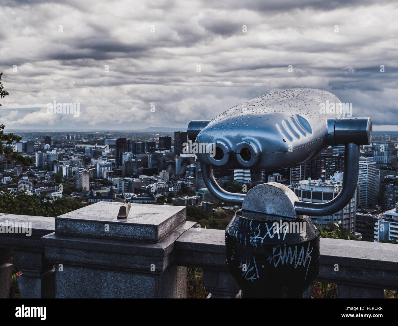 tourist viewpoint with telescope looking to downtown montreal canada cloudy - Stock Image