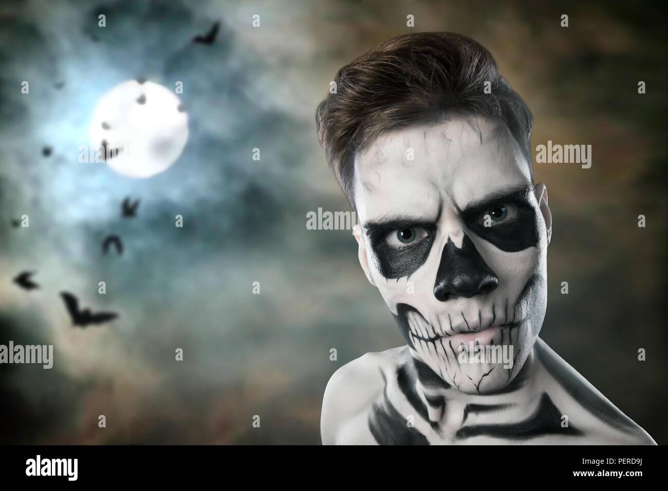 Devil mask in full moon night at halloween - Stock Image